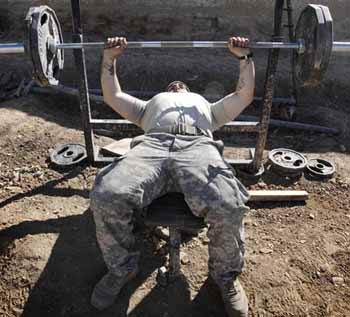 soldier lifting weights