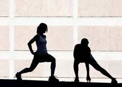 man and woman performing Flexibility and Stretching Exercises