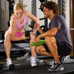 Exercising with a Personal Trainer - Personal Trainer and Client