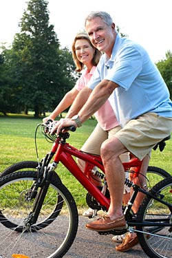 healthy older couple riding bike