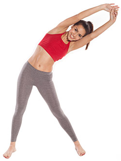 woman stretching for muscle recovery