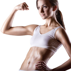 Fit woman flexing her biceps after strength training
