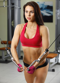 beautiful woman performing weight training