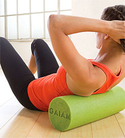 woman using foam rolling for muscle recovery