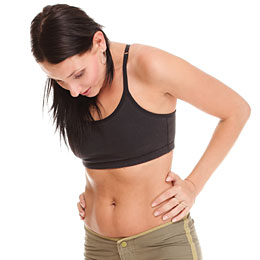 woman looking at stomach post pregnancy