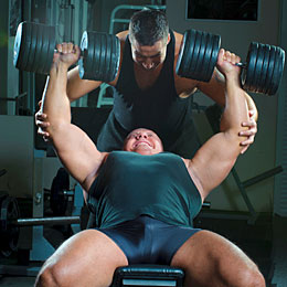 man working out with spotter