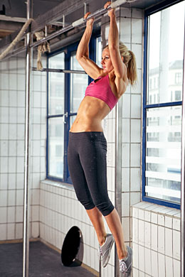 woman performing pull ups exercise