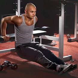 man performing triceps dips