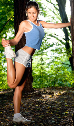 woman stretching outdoors park workout