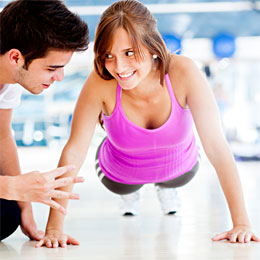 male-personal-trainer-with-female-client